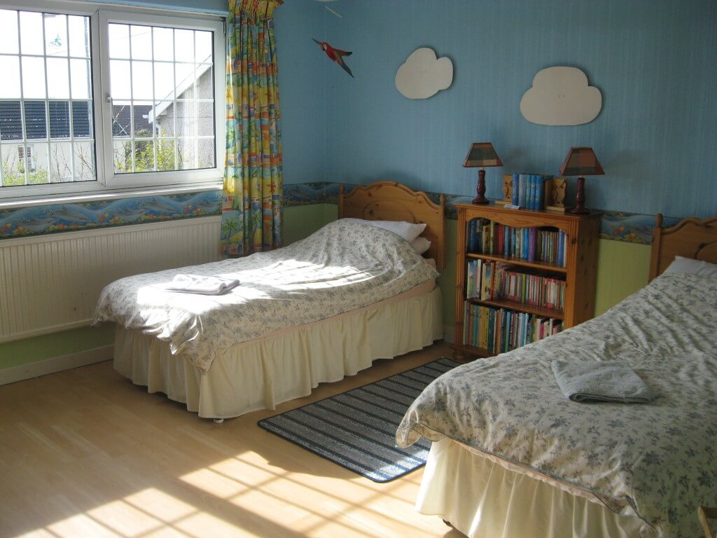 One of the three twin bedrooms
