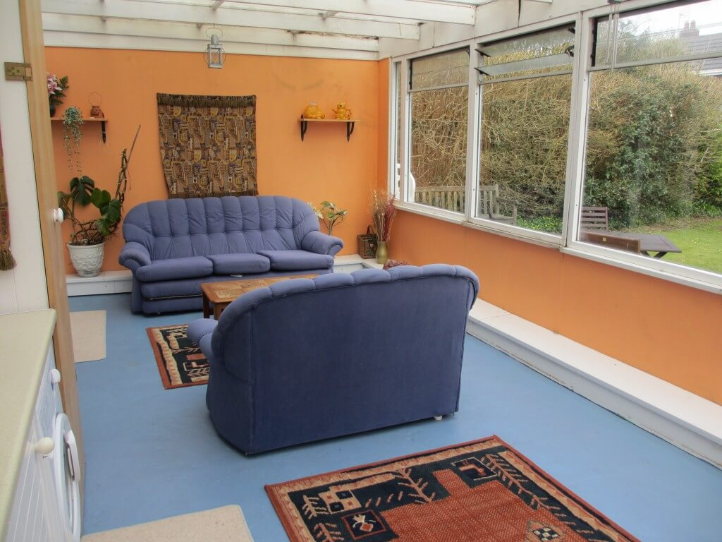 Enjoy the soft seating in the garden room during your self catering holiday